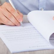 Businessman Signing Contract At Desk
